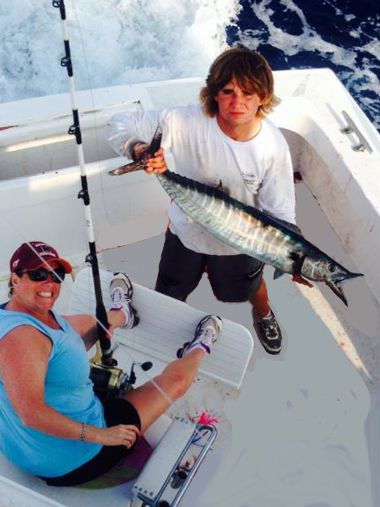 Offshore fishing in August for Wahoo pays off for this lady vacationing in von NC.
